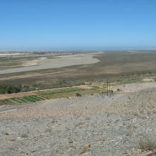 View of the Orange River Mouth from Swartkop looking west.  The river mouth is in the centre of the picture.
