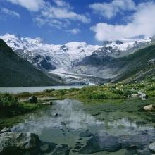 Alluvial zone including a mountain lake and the Roseg glacier.