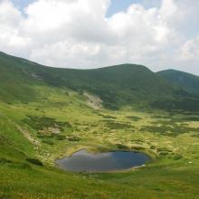 A post-glacial kettle under Mount Turkul with the alpine lake Nesamovyte