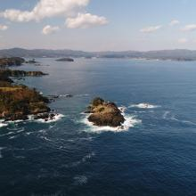 Viewing the gulf from Kamiwarizaki, the south side of the bay's entrance. The island of Matsushima is upfront, while the island of Tsubakishima is located further into the gulf.